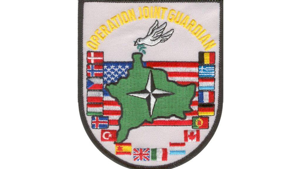 Το έμβλημα της ΝΑΤΟϊκής επιχείρησης στο Κοσσυφοπέδιο